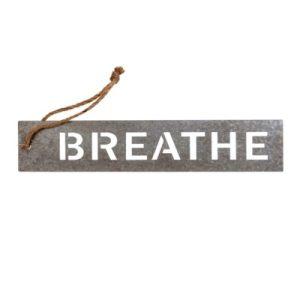 breathe metal sign